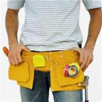 man wearing toolbelt with tools